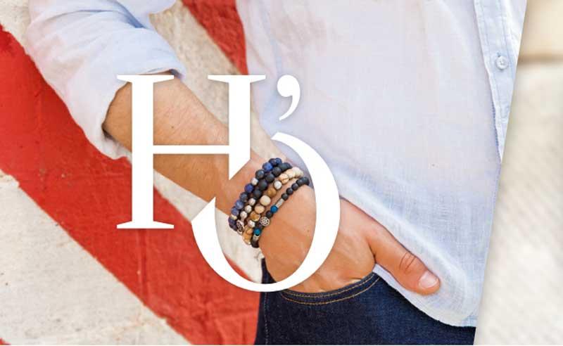 bras d'hommes avec bracelet de perles